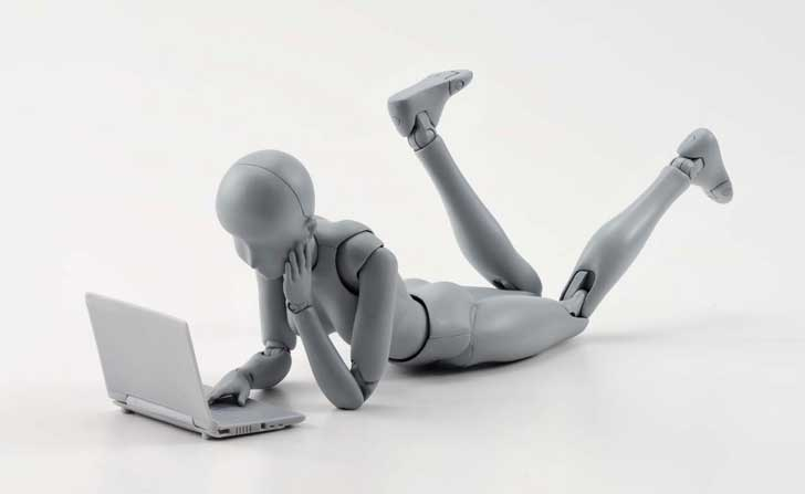 Anatomy Tools Review female figure lying on floor with laptop